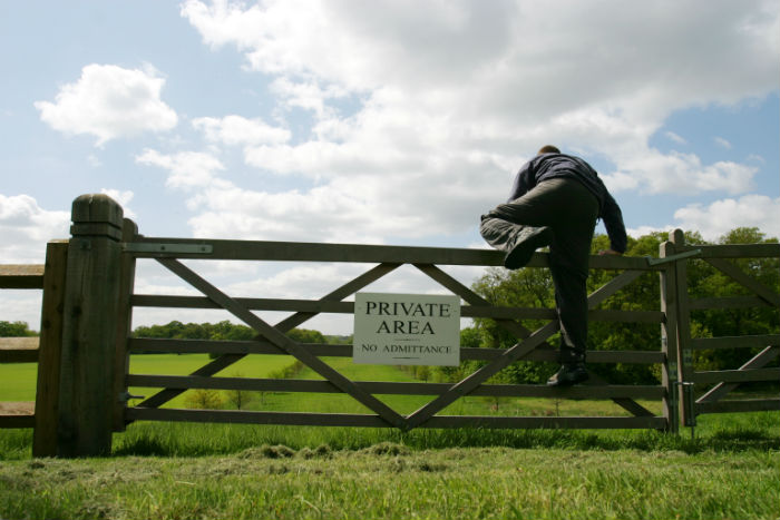 farm-gate-man-climbing-over-private